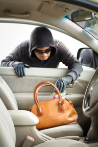 Car_theft-stealing_purse-iStock_000043848156_Small