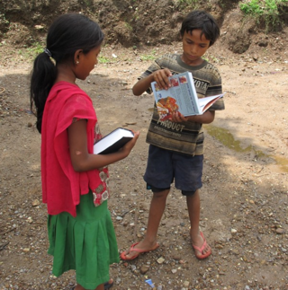 Showing book to Hindu neighbor boy after distribution
