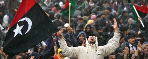 Opposition-supporters-pray-in-the-rain-in-benghazi-libya-pic-getty-172386923