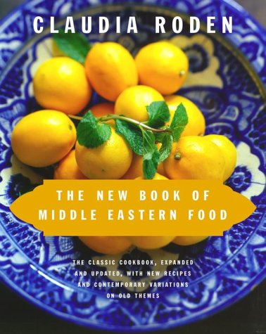"""The New Book of Middle Eastern Food In this updated and greatly enlarged edition of her Book of Middle Eastern Food, Claudia Roden re-creates a classic. The book was originally published here in 1972 and was hailed by James Beard as """"a landmark in the field of cookery""""; this new version represents the accumulation of the author's thirty years of further extensive travel throughout the ever-changing landscape of the Middle East, gathering recipes and stories."""