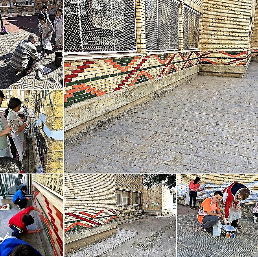 Estudiantes y profesorado repasando y restaurando los colores de las antiguas cenefas / Banco imágenes: ¡Qué bonito es mi cole!