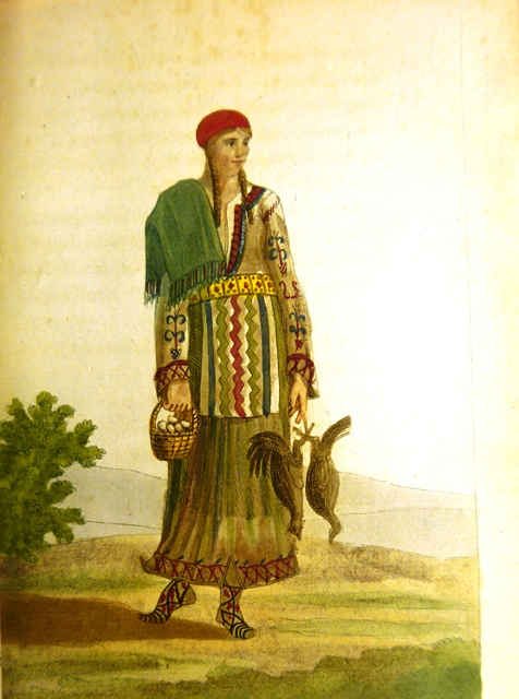 A Montenegrin woman in traditional dress carrying a basket of eggs and two chickens