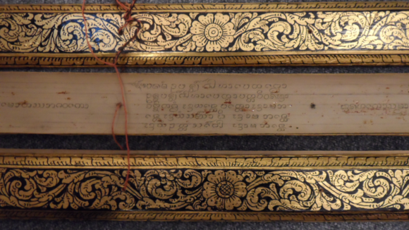 Buddhist manuscript in Tham script from Lanna or Laos with black lacquered covers and gilt floral decorations, 19th century. British Library, Or.16734.