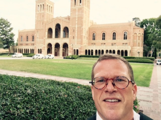 Adrian in front of Royce Hall