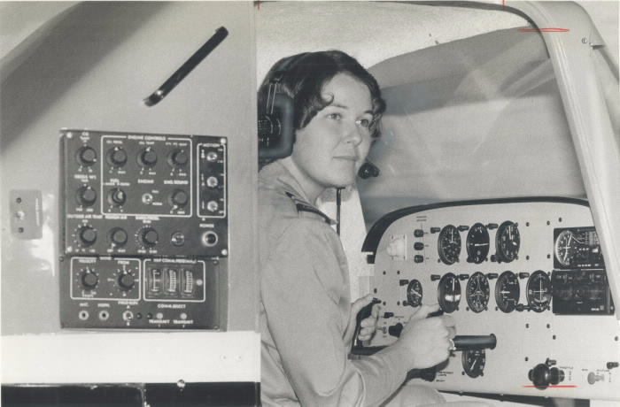 Captain Leah Mosher on the controls of a flight simulator