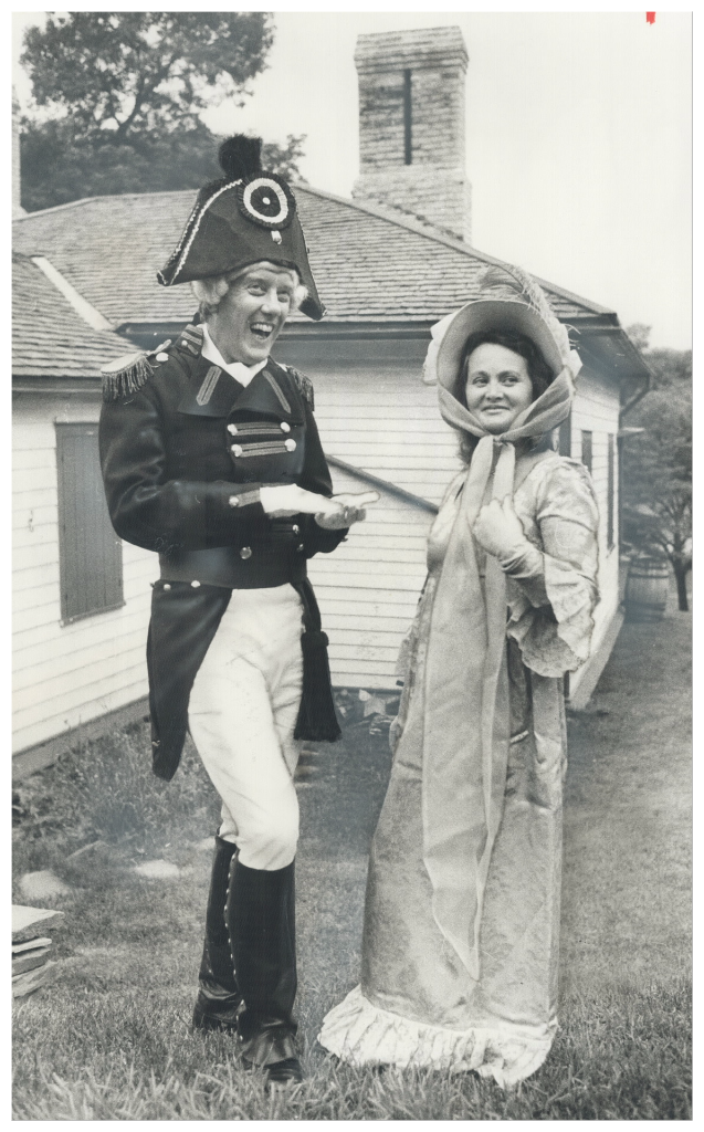 Costumed as John Graves Simcoe, Michael Stevenson discusses role with Maureen Patterson, Simcoe's wife Elizabeth during Simcoe Day in 1976 at Todmorden Mills