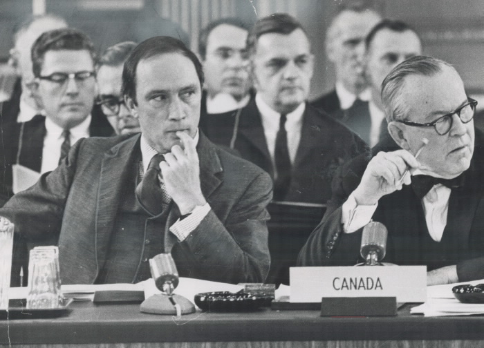 Justice Minister Pierre Elliott Trudeau sits with advisers at a constitutional conference in Ottawa, 1968